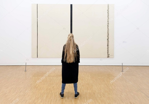 girl in front of painting by barnett newman in museum
